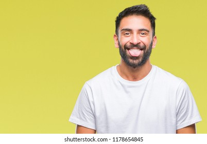 Adult hispanic man over isolated background sticking tongue out happy with funny expression. Emotion concept.