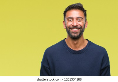 Adult hispanic man over isolated background with a happy and cool smile on face. Lucky person.