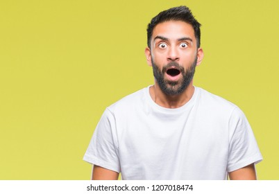 Adult hispanic man over isolated background afraid and shocked with surprise expression, fear and excited face.