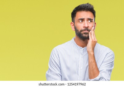 Adult hispanic man over isolated background thinking looking tired and bored with depression problems with crossed arms.