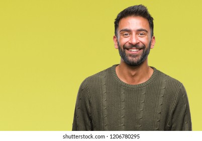 Adult hispanic man wearing winter sweater over isolated background with a happy and cool smile on face. Lucky person.