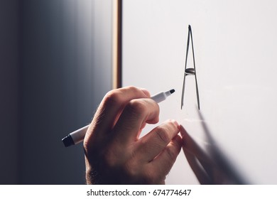 Adult illiteracy concept, man learning to write letter A on whiteboard