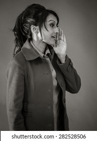 Adult indian woman in studio isolated on grey background, black and white image