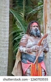 Adult Indigenous Australianman holding boomerangs in Queensland, Australia.