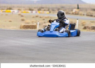 Adult Kart Racer on Track