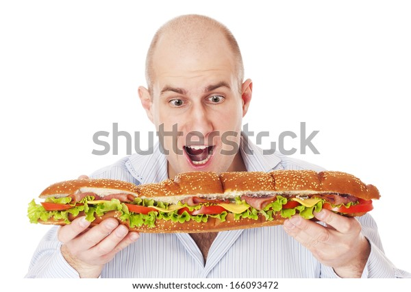 Adult mad man with big sandwich isolated on white background focused on man.