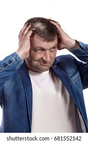 Adult male actor in denim jacket showing different emotions and posing against white background in studio