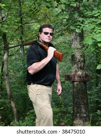 Adult male carrying a shotgun