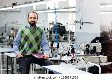 Adult male designer in factory.