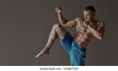 Adult male fighter MMA. In a studio.