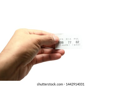 adult male hand holding a white paper data of systolic ,diastolic and pulse  after examination with tester tool on white background