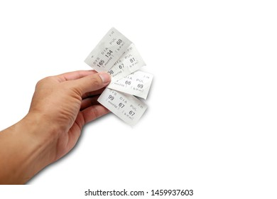 adult male hand holding a white paper data of systolic ,diastolic and pulse  after examination with tester tool on white background with light shadow