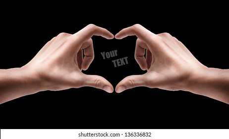 Adult male hands shows heart shape isolated on black background. High resolution