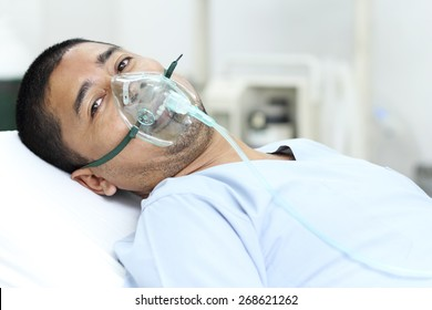 Adult male patient in the hospital with oxygen mask.