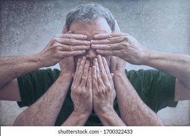 """Adult male photographic representation of the principle """"see no evil, hear no evil, speak no evil"""" with hands over eyes, mouth, and ears. A composite photograph. Conceptual."""