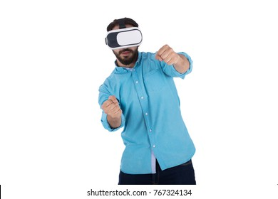 adult male wearing aqua shirt is driving a race car while  using VR-headset. Isolated on white background.