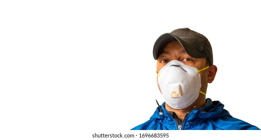 An adult male worker is wearing an N95 respirator mask and looking into the camera lens. White background for copy space.