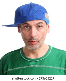adult man in a baseball cap with a grimace on his face