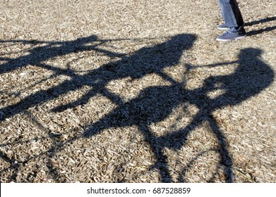 Adult man (Child Sex Offender) watching children playing in the playground trying to steal child. Kidnapping and child abuse concept.