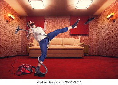 Adult man dancing with vacuum cleaner