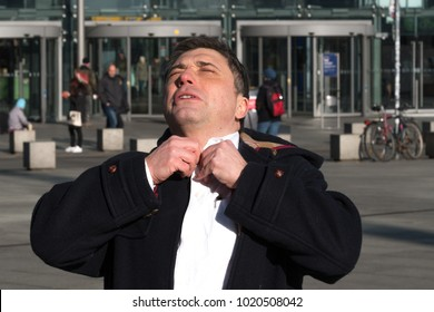 Adult man with difficulty in breathing due to panic attack. Outdoors