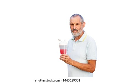 Adult man drinks vitamin supplement