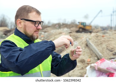 Adult man the ecologist. He studies the problems of ecology arising from the removal of construction debris and soil contamination.