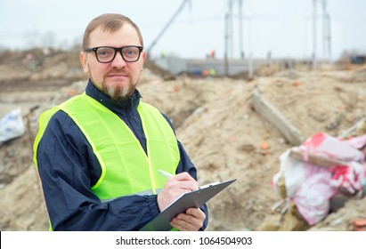 Adult man ecologist. He studies the problems of ecology arising from the removal of construction debris and soil contamination.