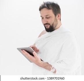 Adult man Hajj holding tablet