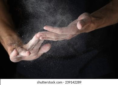 adult man hands work with flour, dark photo