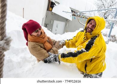 Adult man having fun in big snow