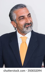 Adult man, mature, in suits. Bearded, grizzled, he thinks, deep in thought. Facial expressions, making faces.