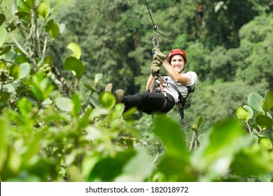 Adult Man On Zip Line Andes Rain Forest In Ecuador