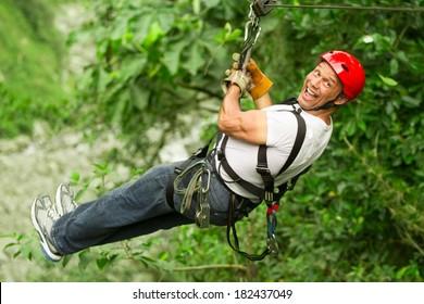 Adult Man On Zip Line Ecuadorian Andes