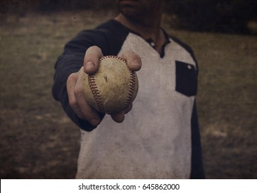 Adult man at pitching practice for baseball, holding ball to throw strikes.  Grunge and dark feel to object.  Great for sport themes or team graphics or decor print.