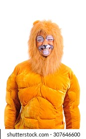 An adult man in a plush lion costume fooling around and grimace his painted face, close-up portrait, isolated