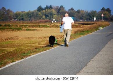 Adult man running with dog