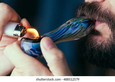 Adult Man Smoking Medical MArijuana Close Up. Selective Focus.