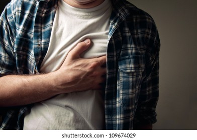 Adult man suffering from severe heartache.