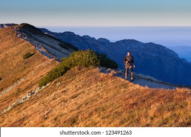 Adult man is walking at Ornak Peak in Tatra Mountains, Poland