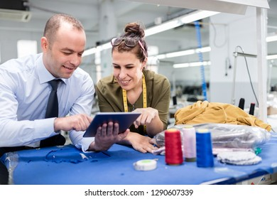 Adult man and woman in factory