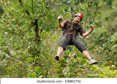 Adult Man Zip Line Adventure In Ecuadorian Rainforest