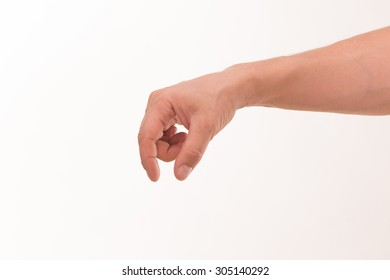 Adult man's hand holding something flat isolated on white background. It is not difficult for him to have something in his hand.