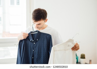 Adult men in pajama picking cloth for work, it's morning and he is ready for new day