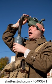 Adult men in protective clothing with gas mask outdoor