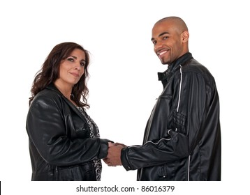 Adult multicultural couple holding hands. Mature woman with younger man.