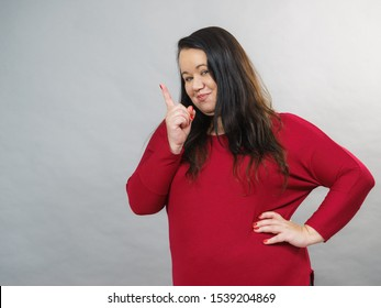 Adult plus size woman say no by shaking wagging her finger, rejecting gesture, disagree sign.