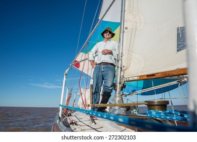 Adult relaxing leisure activity. Sailing South America.