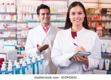 adult russian team of pharmaceutist and technician working in chemist shop