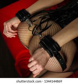Adult sex games. Submissive girl in bondage prepare for punishment. - Image